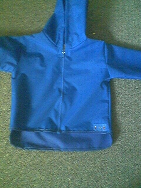 Waterproof Unlined Jacket Curved Hem & Full zip from 6/9 months to 8 years